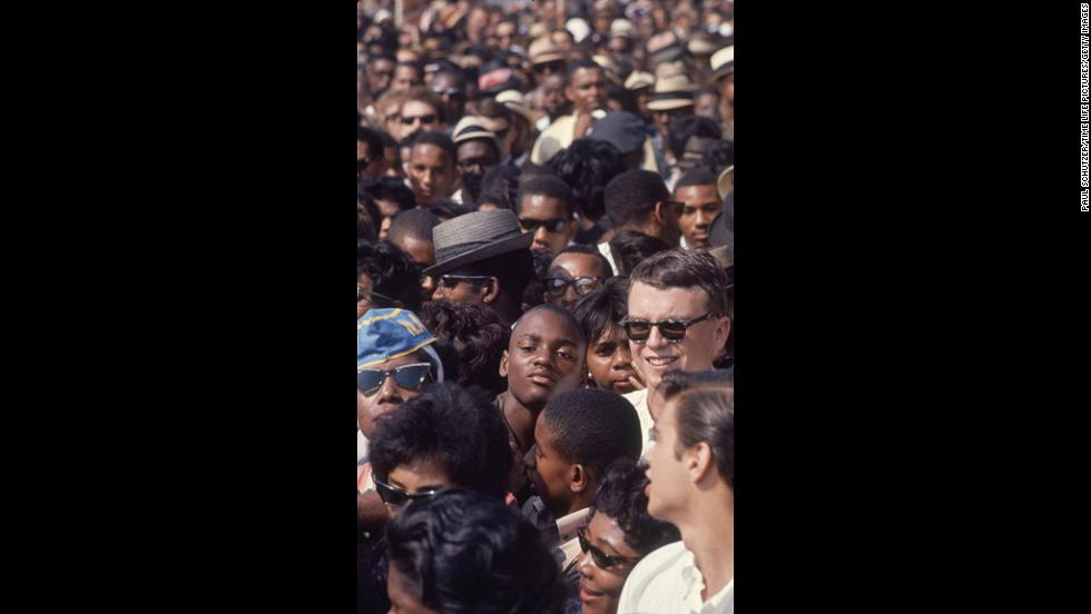 Demonstrators crowd together as they listen to civil rights speakers during the rally.