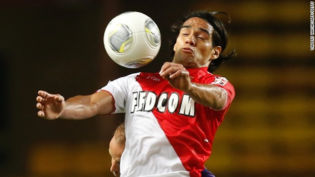 Monaco's Radamel Falcao battles for the ball in front of empty stands in their home match against Toulouse.