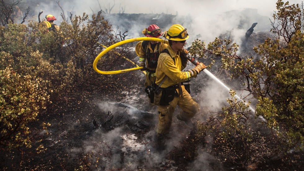 A firefighting crew puts out a spot fire that jumped a fire line in Yosemite National Park on August 23.