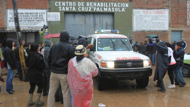 Relatives and media outside Palmasola prison in Santa Cruz, where many inmates were killed in a fire.