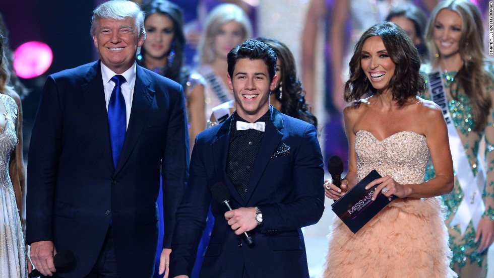 Trump appears on stage with Nick Jonas and Giuliana Rancic during the 2013 Miss USA pageant. Trump has been executive producer of the Miss Universe, Miss USA and Miss Teen USA pageants since 1996.