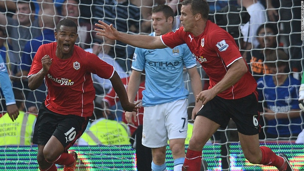 Cardiff striker Fraizer Campbell (left) celebrates with teammate Ben Turner (right) after scoring during the 3-2 victory over Manchester City.