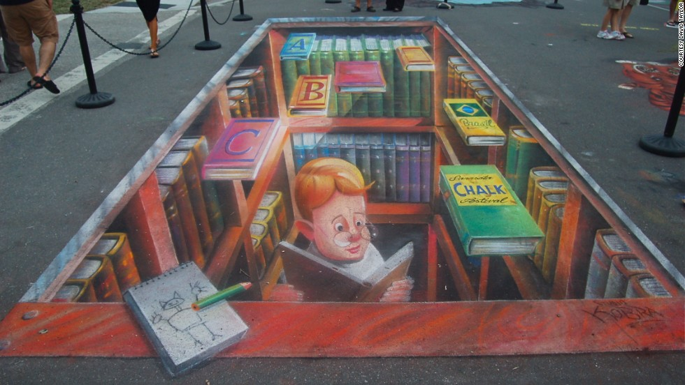 Artist Edwardo Kobra made this 3-D image of a young boy studying chalk art in Sarasota, Florida.
