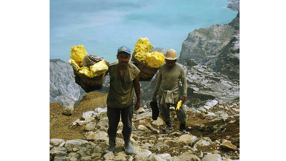 Workers on Kawah Ijen, a volcanic lake in Java, Indonesia, collect sulfur to sell to a refinery. Conditions are treacherous, pungent smoke billows from gashes in the ground and at least one tourist is reported to have died while climbing down the crater. But local miners spend hours here each day mining sulfur, earning around $10 a day.