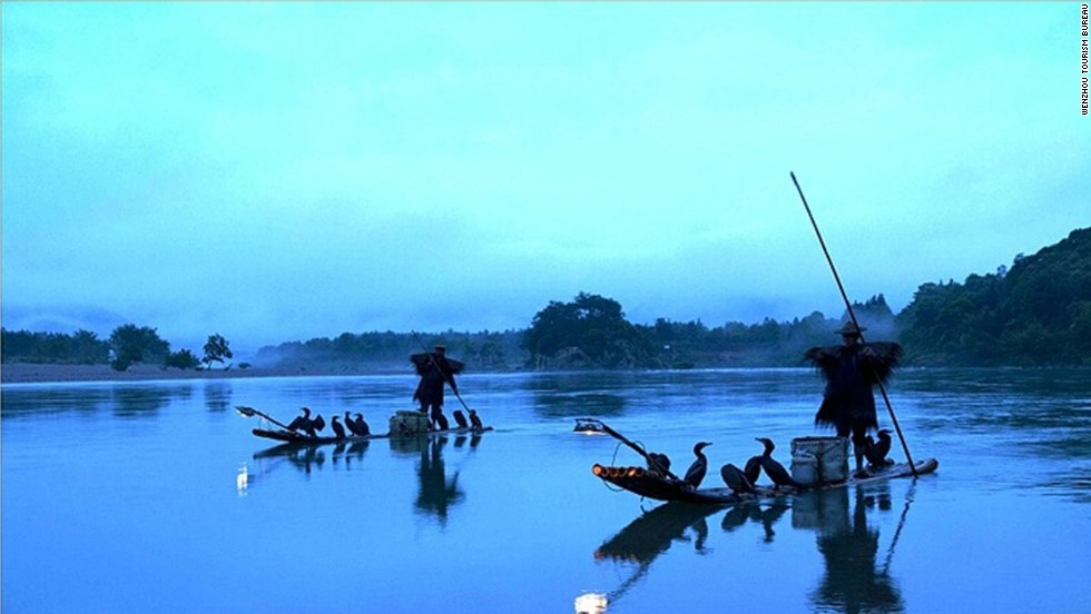 With its mountain backdrop and shores lined with ancient houses, the Nanxi River inevitably became the cradle of classic Chinese water-and-ink painting. It's also where travelers can watch local fishermen team with cormorants to catch fish.