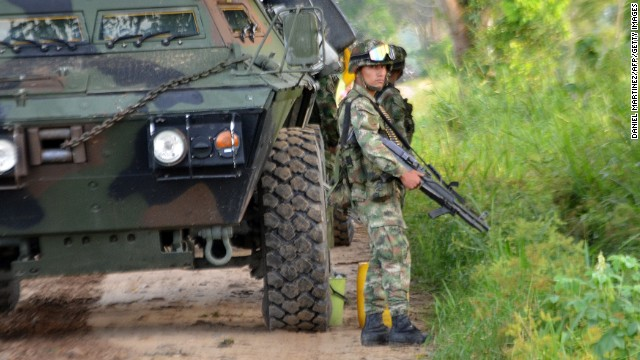 A Colombian soldier stands guard in the town of Tame, Arauca department, on August 25, 3013.