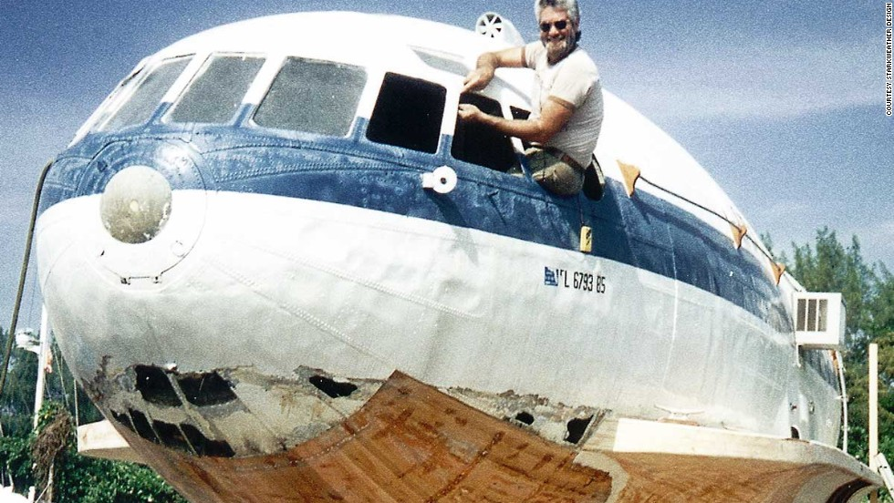 "Owner Dave Drimmer, rebuilding the hull of his ""planeboat"" in 1994."