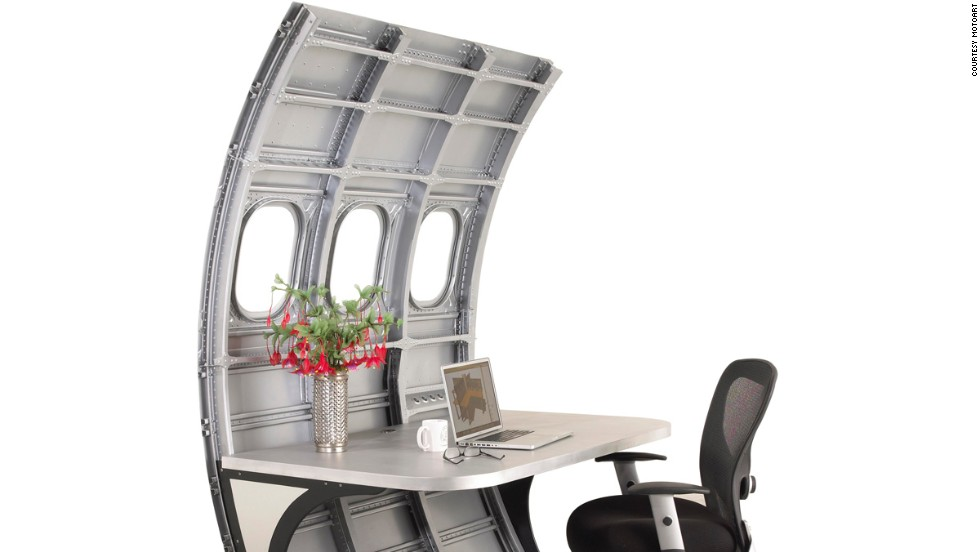 A section of airplane fuselage, pretty much useless on its own. Add a desk and it becomes a stylish aluminum alloy partition that also happens to be extremely tough and durable.
