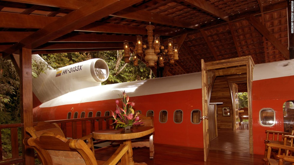 The emergency door on the 727 leads to a relaxing lunch area on the patio, built above the right wing of the airplane. Unexpected guests may include sloths and monkeys.