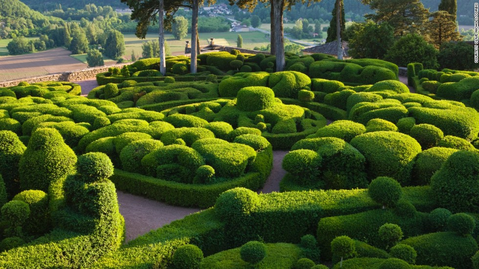 Nearly four miles of paths curl around 54 acres of hand-shaped gardens and lands.