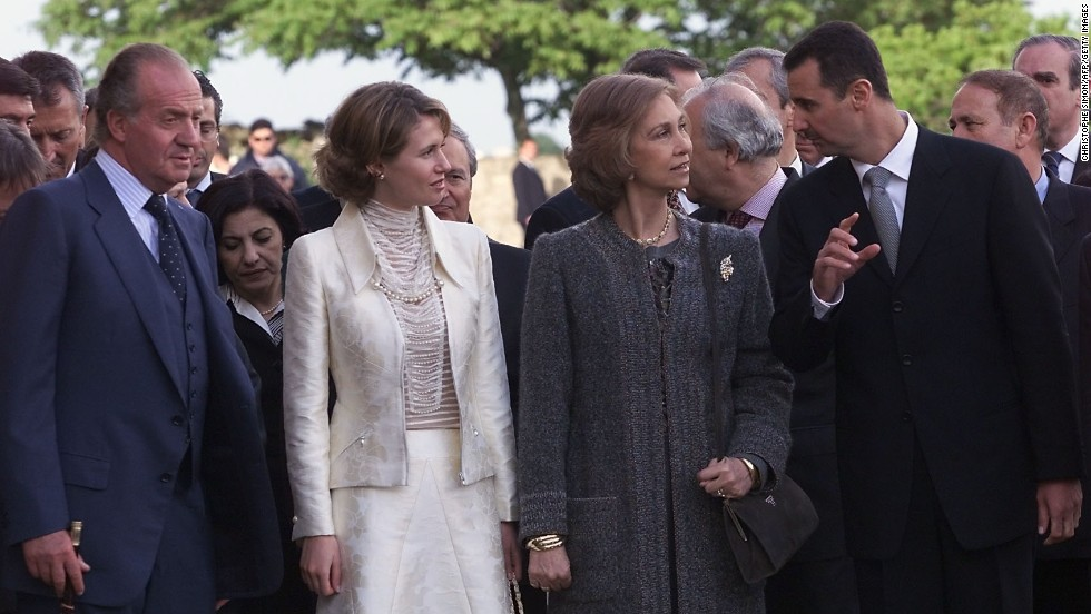 "Syrian President Bashar al-Assad, right, and wife Amsa al-Assad, second from left, speak with the Spanish Queen Sofia and King Juan Carlos as they inaugurate the show ""El Esplendor de los Omeyas Cordobeses,"" on May 3, 2001, in Cordoba, Spain."