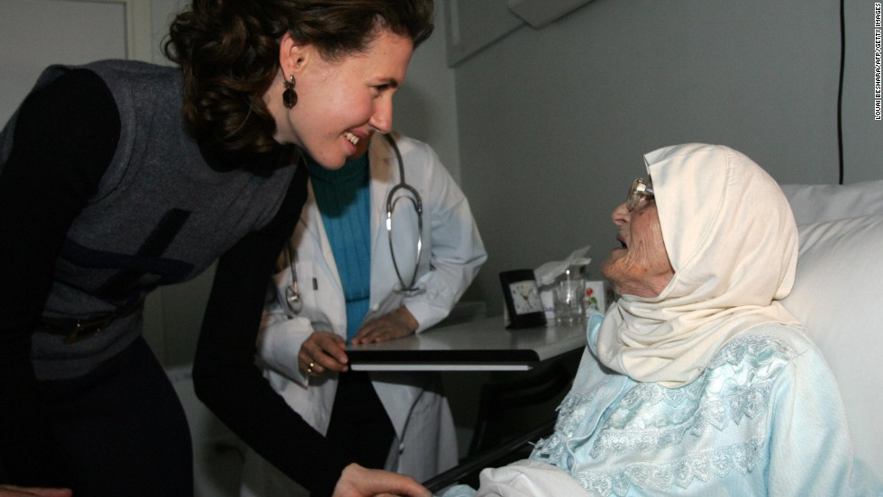 On the first day of the Eid al-Adha, Asma al-Assad visits a resident at a home for the elderly in Damascus, on December 19, 2007.