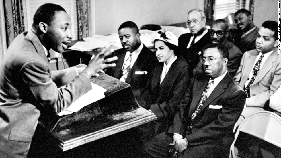 King outlines boycott strategies to his advisers and organizers on January 27, 1956. Seated are the Rev. Ralph Abernathy, left, and Rosa Parks, center, who was the catalyst for the protest of bus riders.