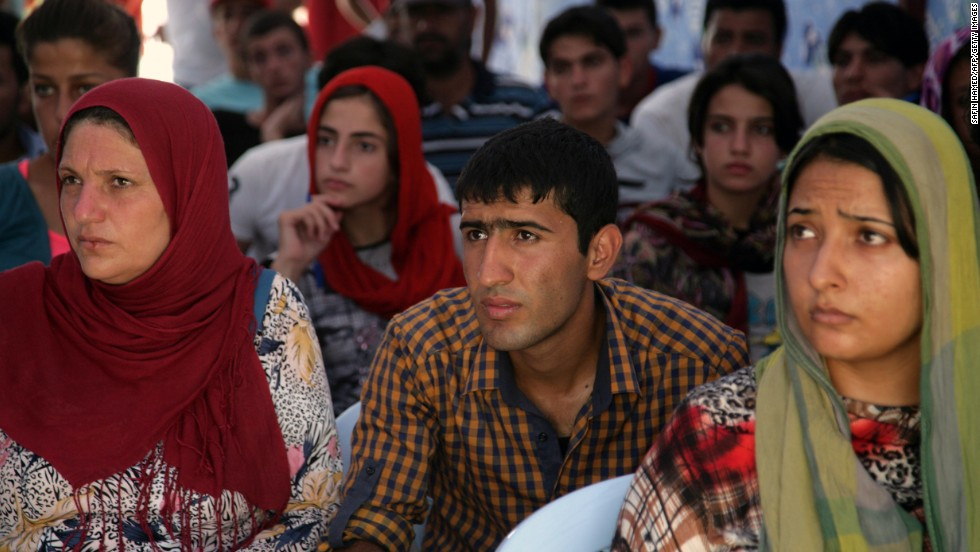 Syrian refugees listen to safety instructions at the Quru Gusik refugee camp in August 2013.