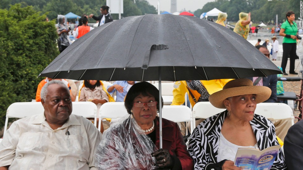 Stanley Samuels and Rita Samuels, from Atlanta,left, and Sammie Whiting-Ellis, from Washington, wait for the anniversary program to begin.