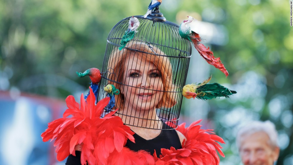 "Marina Ripa di Meana wears a birdcage head ress for the screening of the film ""Gravity."""