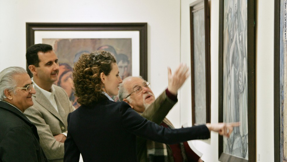 Bashar and Asma al-Assad listen to Syrian artist Elias al-Zayat during a visit to an exhibition at the national museum in Damascus on February 23, 2008.