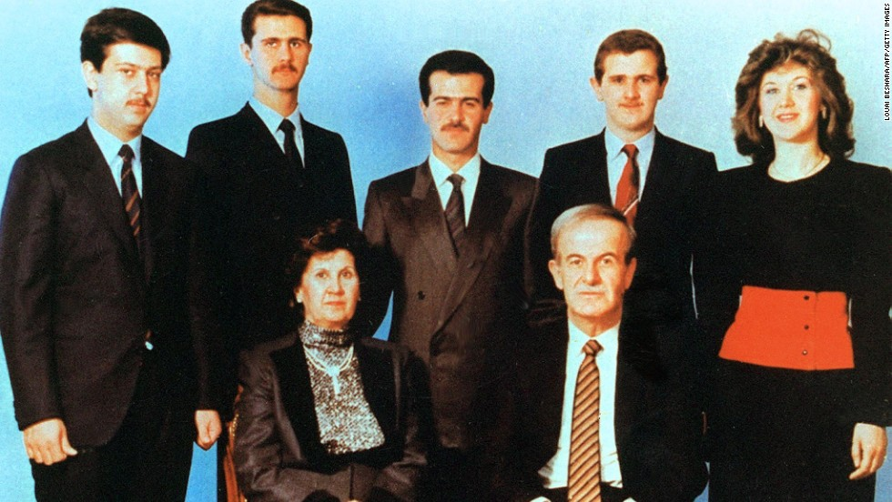 An undated photo shows current Syrian President Bashar al-Assad, second from left, posing with his family.  Al-Assad's parents, then-President Hafez Assad and his wife, Anisa, in front, and his siblings in the second row; Maher, Bassel, Majd and Bushra.