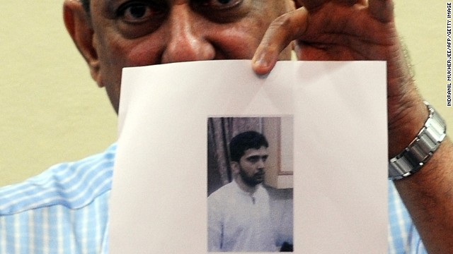 Mumbai's anti-terrorism police chief, Rakesh Maria holds photographs of Yashin Bhatkal in Mumbai on January 23, 2012.