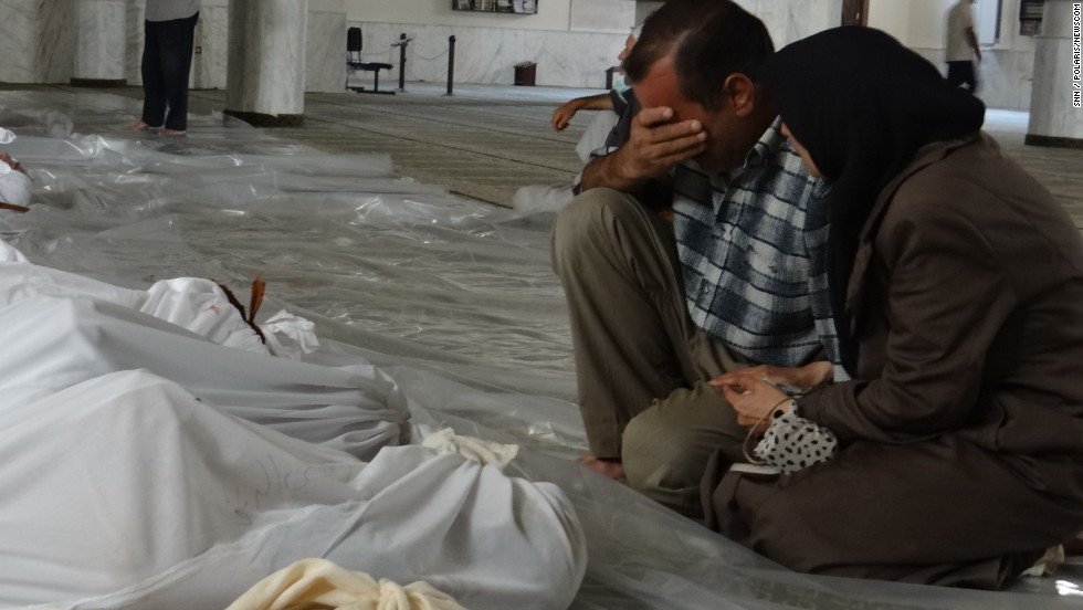 "A man mourns over the bodies of those killed in a suspected chemical weapon attack in a suburb of Damascus, Syria, on Wednesday, August 21. Syrian rebels said poisonous gas rained down from rockets, but authorities have denied the allegations that they used chemical weapons and accused the opposition of staging the attacks. U.S. officials, however, said there were ""strong indications"" that there was a chemical weapons attack by the government."