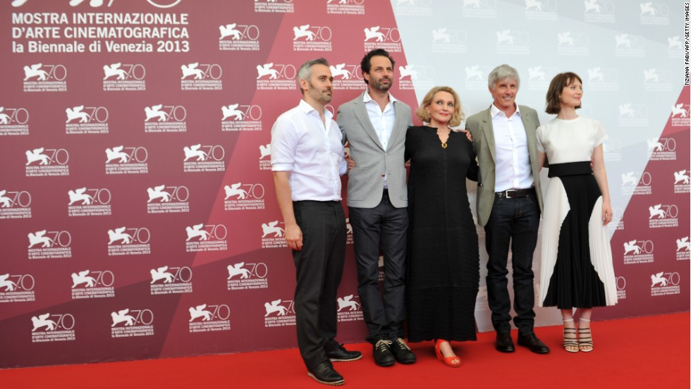 "From left, producers Ian Canning and Emile Sherman, Australian writer Robyn Davidson, U.S. director John Curran and Australian actress Mia Wasikowska, pose during the photocall of ""Tracks"" on August 29."