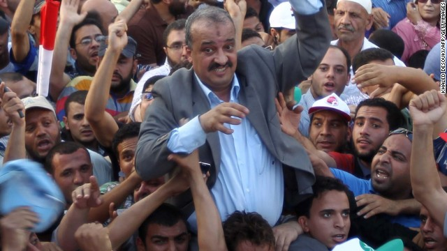 Mohamed El-Beltagi (C) is carried by supporters during a rally in Cairo's Tahrir square on June 5, 2012.