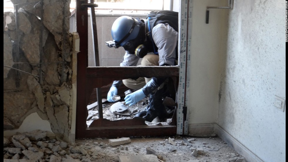 A U.N. arms expert collects samples during an inspection of a suspected chemical weapons strike site in the Ghouta area outside Damascus on August 29.
