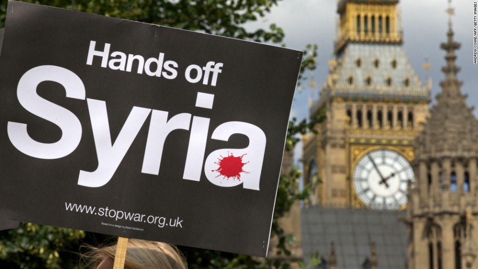 Demonstrators protest against military involvement in Syria outside the Houses of Parliament in London on Thursday, August 29. British Prime Minister David Cameron failed to secure Parliament's approval for military intervention in Syria. Western powers have debated the use of military force against Syria's government in response to a chemical weapons attack outside Damascus.