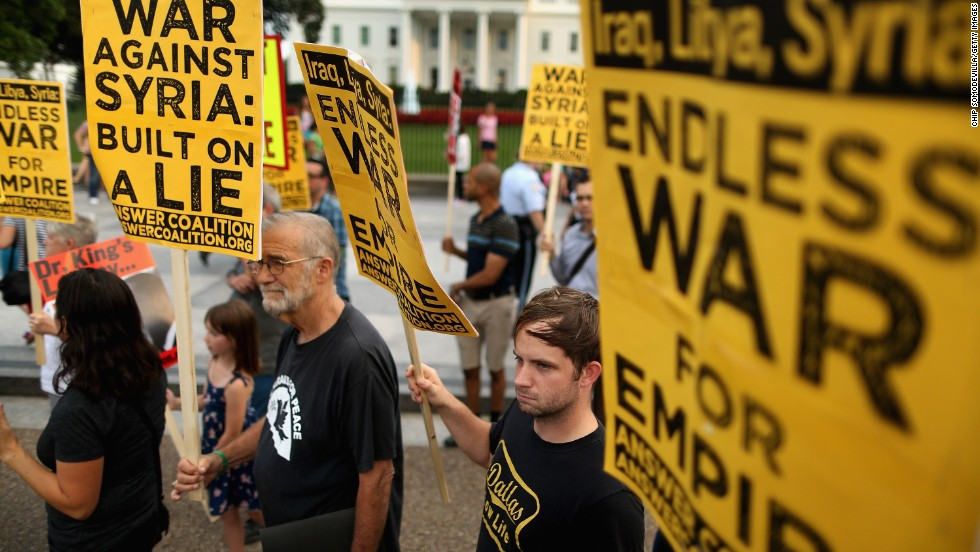 Demonstrators, including former CIA analyst Ray McGovern, second from left, gather on the north side of the White House to protest possible U.S. military action against Syria on August 29.
