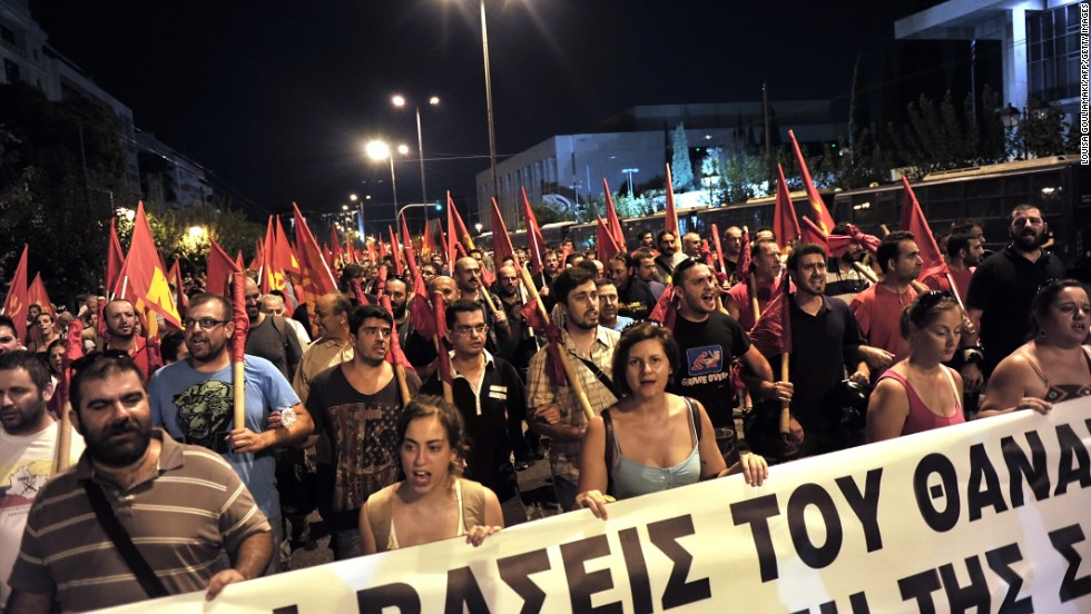 Protesters rally in front of the U.S. Embassy in Athens, Greece, on August 29 against potential NATO military action and Greek involvement in Syria.