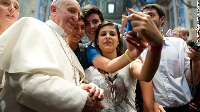 In this photo provided Thursday, Aug. 29, 2013 by the Vatican newspaper L'Osservatore Romano, Pope Francis receives a gift from youths from the Italian Diocese of Piacenza and Bobbio who came to Rome for a pilgrimage, inside St. Peter's Basilica, at the Vatican, Wednesday, Aug. 28, 2013. The pontiff had a private audience with 500 youths from the diocese. (AP Photo/L'Osservatore Romano, ho)