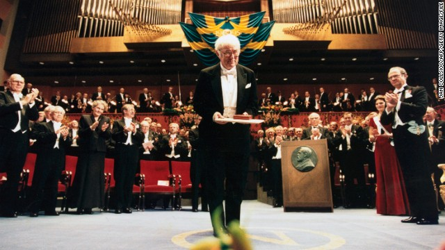 Seamus Heaney poses with the Nobel Prize for Literature he received from Sweden's King Carl Gustav XVI in December 1995.