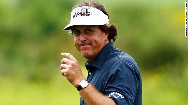 Phil Mickelson reacts after holing an eagle putt on the second green at the TPC Boston on the way to an eight-under 63.