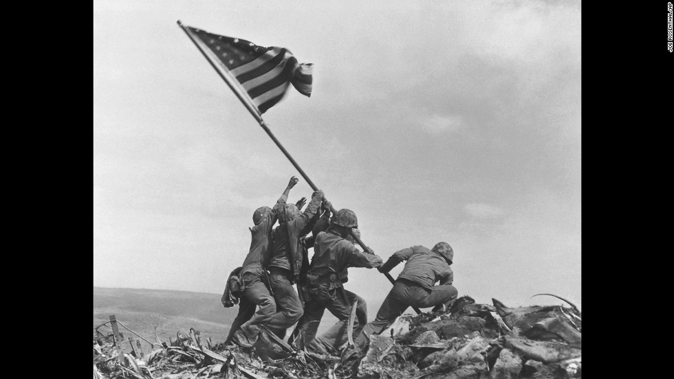 Joe Rosenthal's 1945 photograph of U.S. troops raising a flag in Iwo Jima during World War II remains one of the most widely reproduced images. It earned him a Pulitzer Prize, but he also faced suspicions that he staged the patriotic scene. While it was reported to be a genuine event, it was the second flag-raising of the day atop Mount Suribachi. The first flag, raised hours earlier, was deemed too small to be seen from the base of the mountain. Look back at other photographs that have helped define modern history.