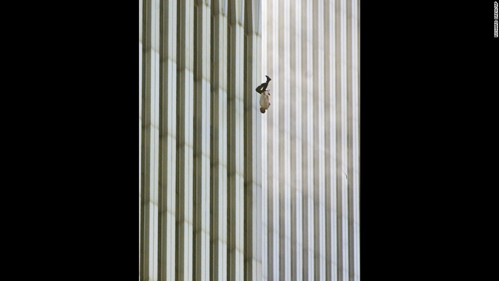 "Richard Drew captured this image of a man falling from the World Trade Center in New York after the terror attacks on September 11, 2001. Its publication led to a public outcry from people who found the photograph insensitive. Drew sees it differently. <a href=""http://www.thedailybeast.com/articles/2011/09/08/richard-drew-s-the-falling-man-ap-photographer-on-his-iconic-9-11-photo.html"" target=""_blank"">On the 10th anniversary of the attacks</a>, he said he considers the falling man an ""unknown soldier"" who he hopes ""represents everyone who had that same fate that day."" It's believed that upwards of 200 people fell or jumped to their deaths after the planes hit the towers."