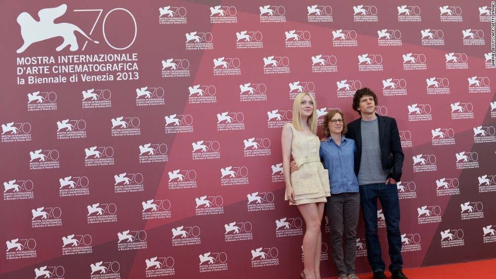"Actress Dakota Fanning, left, with director Kelly Reichardt and actor Jesse Eisenberg, pose during the photo call of ""Night Moves,"" which was presented in the competition at the festival on August 31."