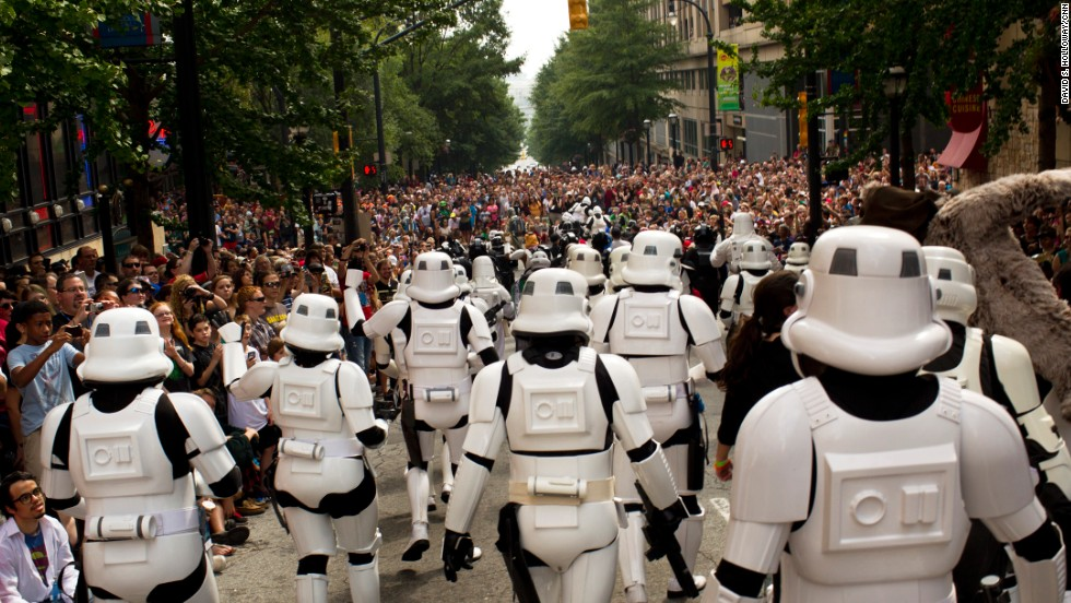 "Stormtroopers from the 501st Legion, an international fan group dedicated to ""Star Wars"" villains, march through the streets of Atlanta."