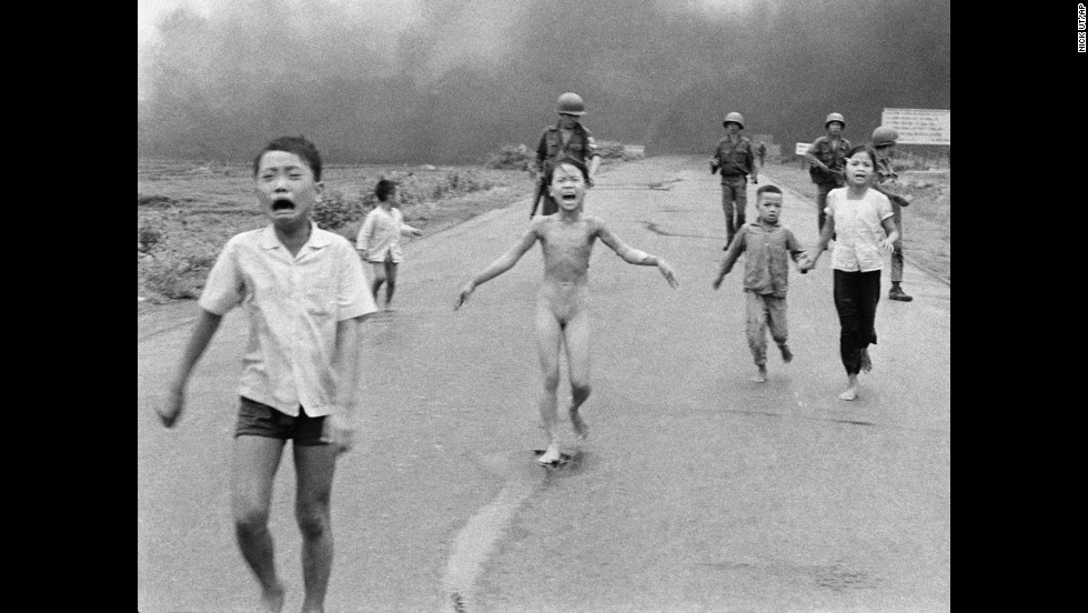 Associated Press photographer Nick Ut photographed terrified children running from the site of a napalm attack during the Vietnam War in 1972. A South Vietnamese plane accidentally dropped napalm on its own troops and civilians. Nine-year-old Kim Phuc, center, ripped off her burning clothes while fleeing. The image communicated the horrors of the war and contributed to the growing anti-war sentiment in the U.S. After taking the photograph, Ut took the children to a hospital in Saigon.