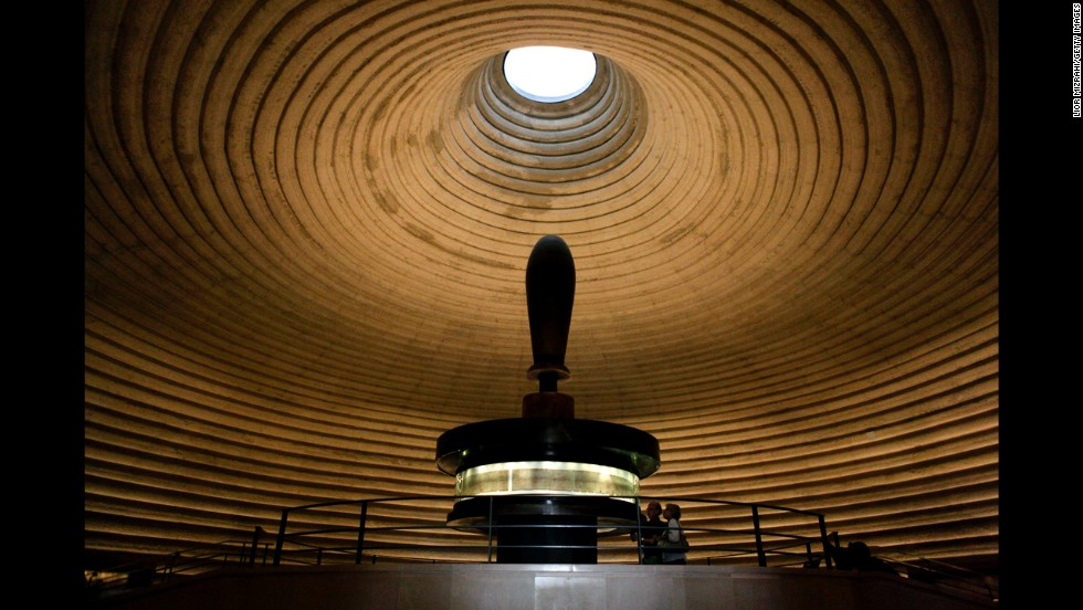 "People look at the Isaiah Scroll, one of the Dead Sea Scrolls, in the vault of the Shrine of the Book at the Israel Museum. With more than 200 museums, Israel has the highest number of museums per capita in the world. Here is a <a href=""http://travel.cnn.com/best-israel-museums-361281"">list of 10 of the best</a>."