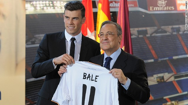 Gareth Bale and Real Madrid President Florentino Perez pose for photographers at the Bernabeu Stadium on Monday.