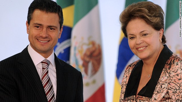 Brazilian President Dilma Rousseff (R) and Mexican elected president Enrique Pena Nieto shake hands before holding a meeting at Planalto Palace in Brasilia, on September 20, 2012. Pena Nieto launched a Latin American tour on Sunday --visiting Guatemala, Colombia, Brazil, Chile, Argentina and Peru-- to discuss security, trade, immigration and drug-related issues. AFP PHOTO/Pedro LADEIRA (Photo credit should read PEDRO LADEIRA/AFP/GettyImages)