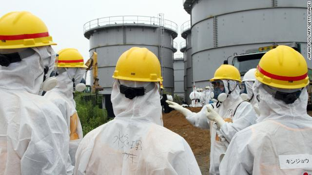 Japan's nuclear watchdog members at the Tokyo Electric Power Co (TEPCO) Fukushima Dai-ichi nuclear power plant in Okuma,