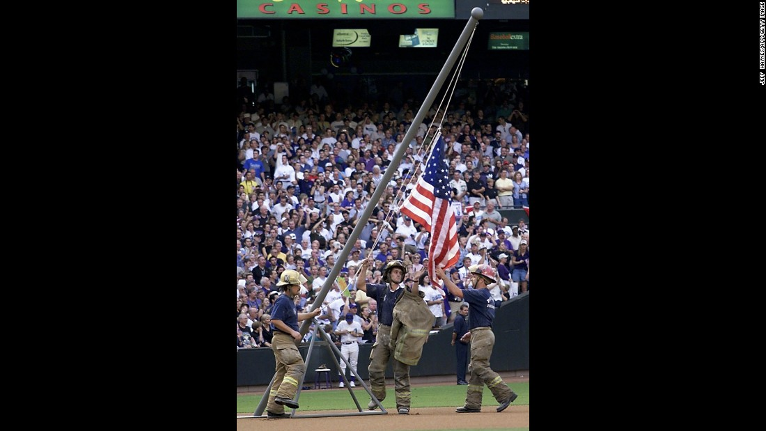 Firemen re-create the flag raising during the 2001 World Series in Phoenix, Arizona, on October 27, 2001.