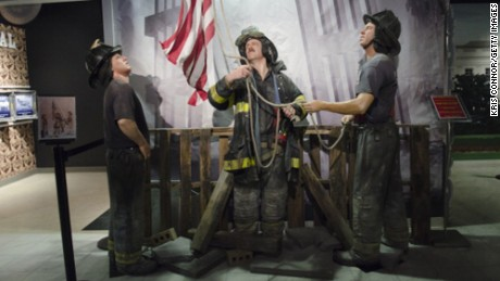 "Wax figures of New York City firefighters raising the American flag at Ground Zero are displayed during the ""HOPE: Humanity And Heroism"" 9/11 wax exhibition at Madame Tussauds in Washington, DC., on May 10."