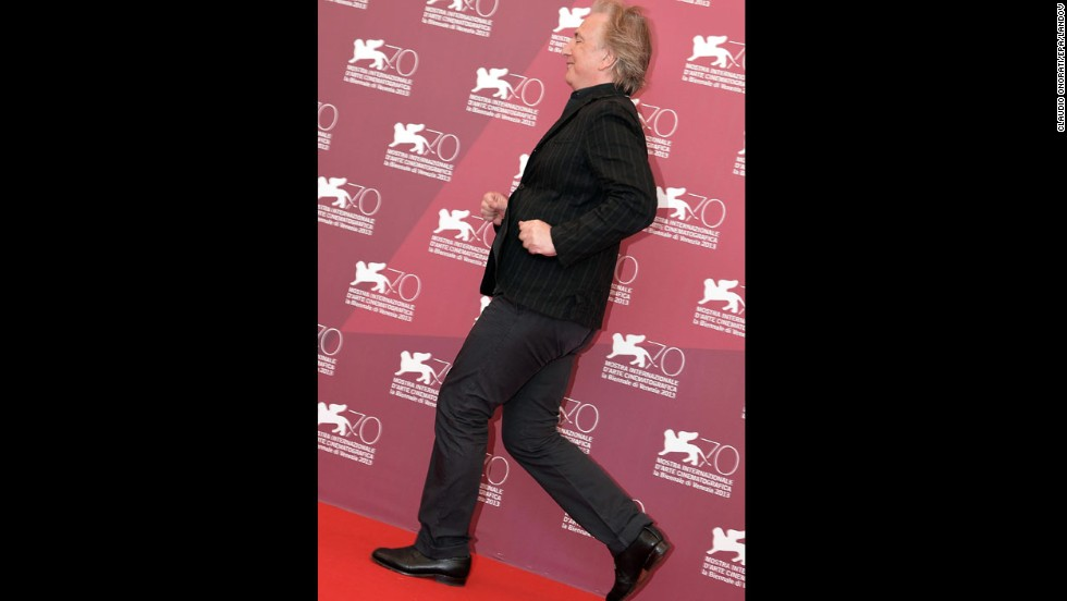 "Actor Alan Rickman goofs around for the camera at a photo call for ""Une Promesse"" on September 4."