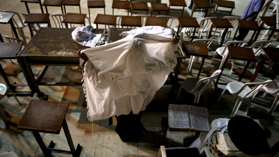 An Orthodox Jewish man prays under a shawl on September 4 in Jerusalem's Old City.