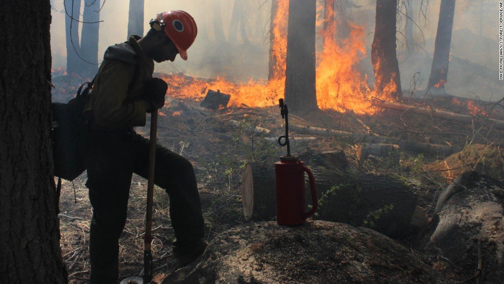 A Hotshot crew member rests near a controlled burn at Horseshoe Meadows as crews continue to fight the Rim Fire near Yosemite National Park in California on Wednesday, September 4. The massive wildfire has burned over 280,000 acres and is now 80% contained, according to a state fire spokesman.