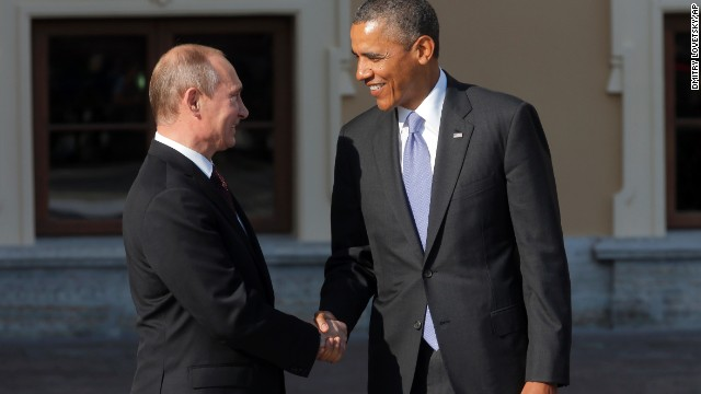 Obama, Putin greet with long handshake