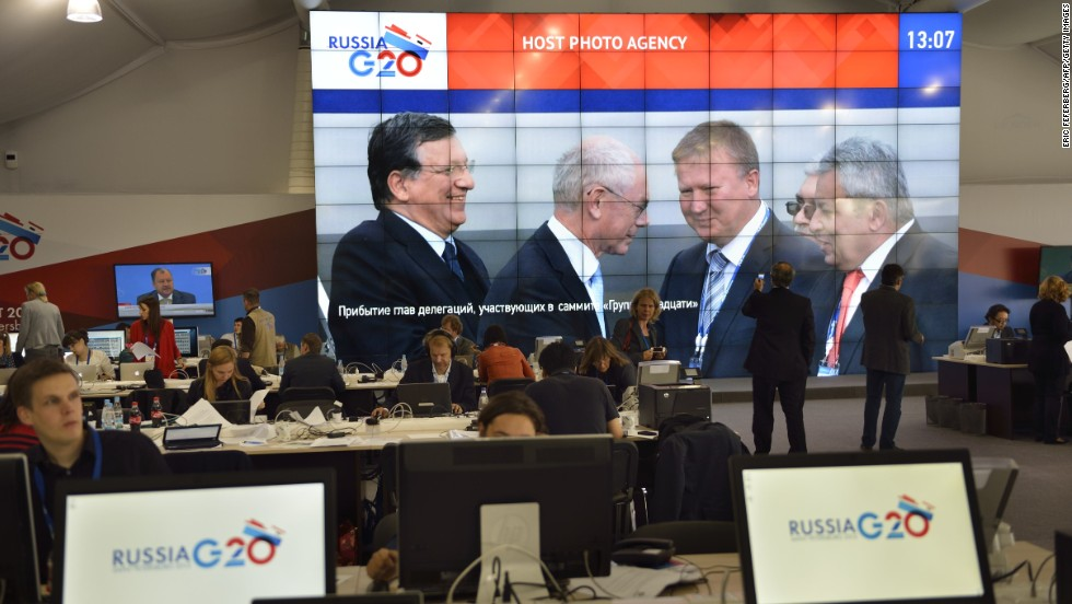 The arrival of European Commission President Jose Manuel Barroso and European Council President Herman Van Rompuy is shown on a giant screen in the main press center prior to the G-20 summit on September 5.