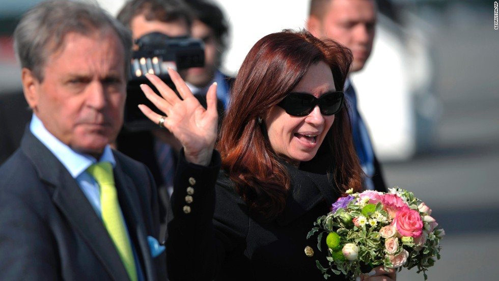 Argentine President Cristina Fernandez de Kirchner waves as she arrives in St. Petersburg on September 4.